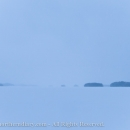 Skiing over endless snow on frozen lake CRW_1168.jpg