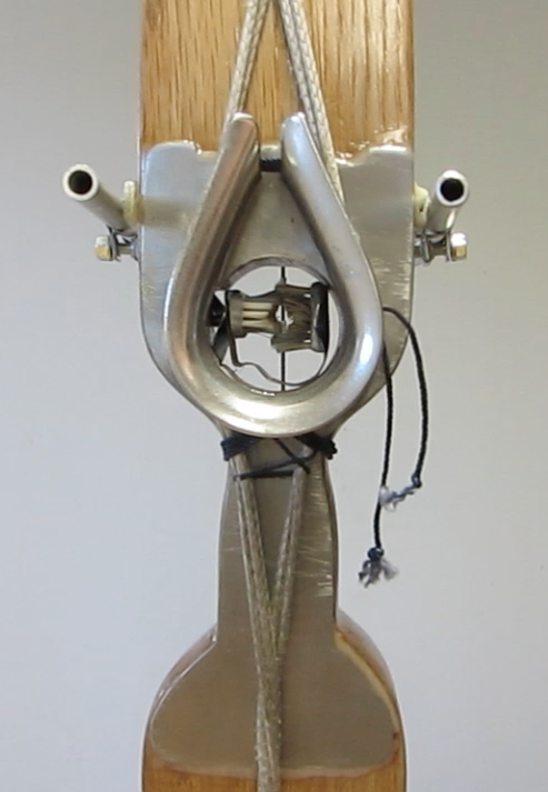 Front view of the dyneema cable backed center-fire bow with aluminum reinforced handle