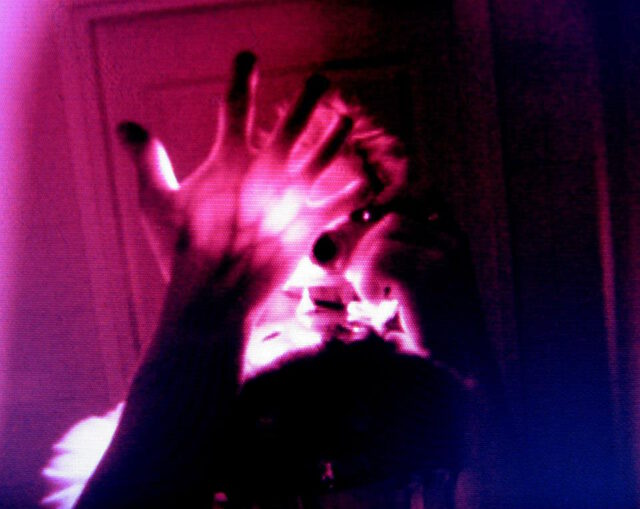Infrared transillumination of a hand, with a treeclimbing helmet equipped with IR cannon.
