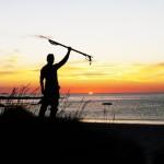 Me standing in front of Atlantis in Ramberg, Norway with my speargun during beautiful sunset. Minä Atlantin auringonlaskussa harppuuna kädessä Norjan Rambergissa.