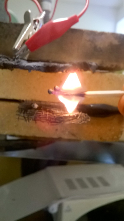 Burning-match-in-strong-electric-field-flames-against-gravity-WP_20160612_001.jpg