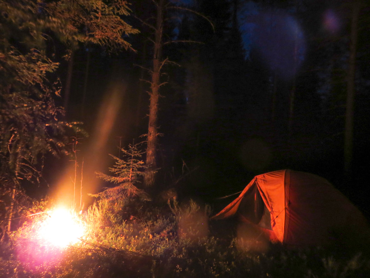 My lonely camp in the middle of night next to a camp fire