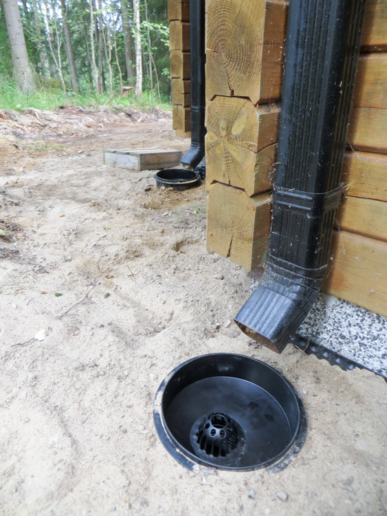 Freshly installed rain water sewers below the downspouts