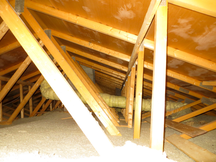Attic wiht blown cellulose and properly insulated ventilation pipes in cold climate