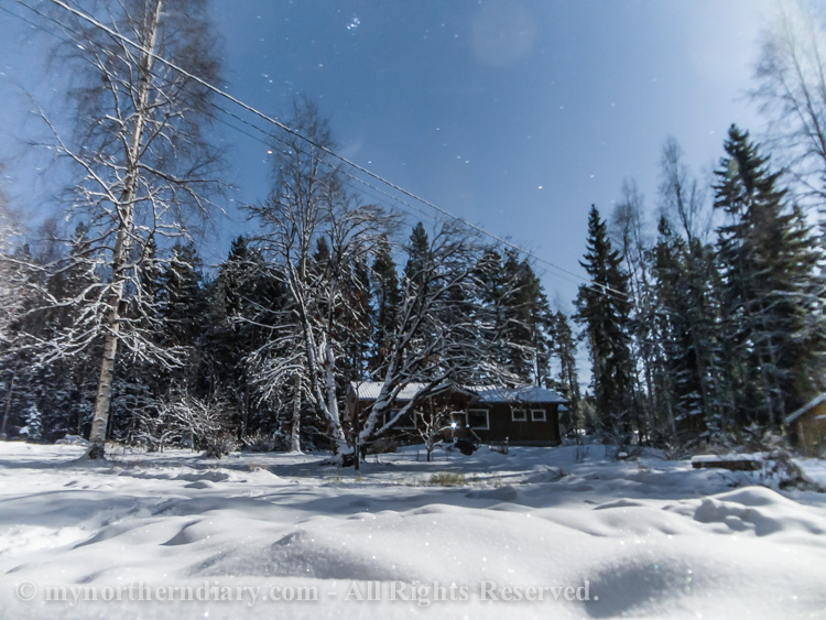 Nocturnal-images-of-log-houses-in-middle-of-cold-and-snowy-northern-forest-under-moon-light-CRW_5831.jpg