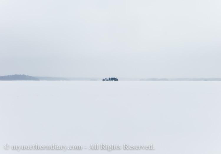 Skiing-over-endless-snow-on-frozen-lake-CRW_1137.jpg
