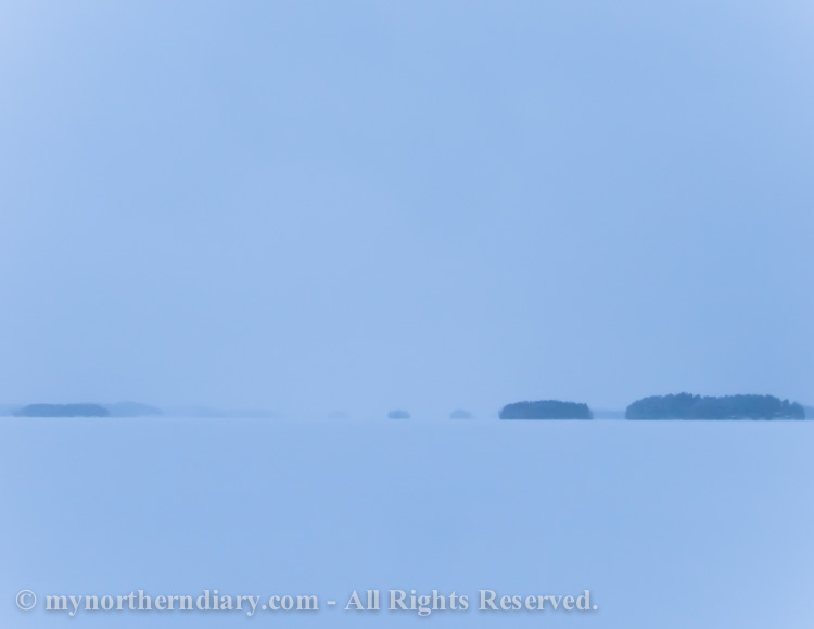Skiing-over-endless-snow-on-frozen-lake-CRW_1168.jpg